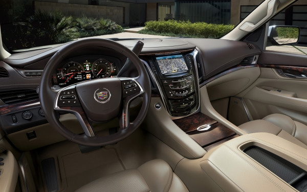 CUE, Cadillac's advanced system for connectivity and control, is standard on the Escalade, featuring state-of-the-art voice recognition with touch controls common with the world's most popular tablets and mobile devices. A standard 12.3-inch digital gauge cluster can be reconfigured with four themes and an available head-up display projects information onto the windshield.