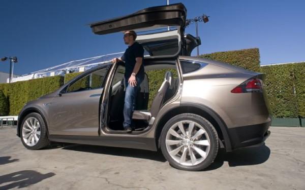 elon-musk-is-standing-inside-the-backseat-of-tesla-model-x